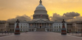 photograph of US Capitol building at dawn