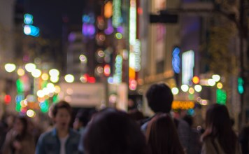 blurred photograph of crowd on busy street at night
