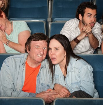 photograph of upset audiency members in a movie theater
