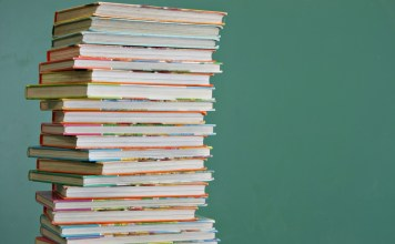 photograph of tall stack of children's books
