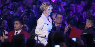 photograph of Britney Spears walking through crowd at event