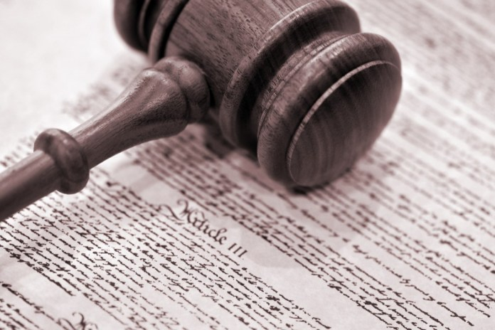 photograph of gavel resting on Bill of Rights