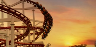 photograph of rollercoaster at dusk