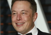 headshot photograph of elon musk in a tux