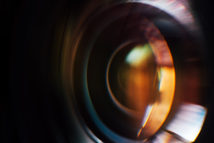 image of camera lens blended with an image of an eye