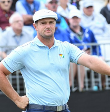 photograph of Bryson DeChambeau at event with crowd in background
