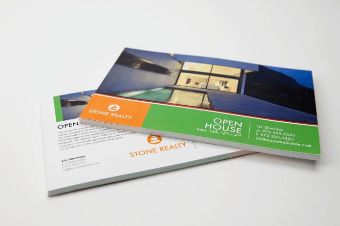 Stack of real estate postcards