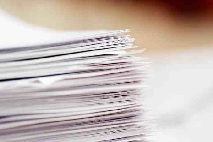 Close up of a stack of white papers