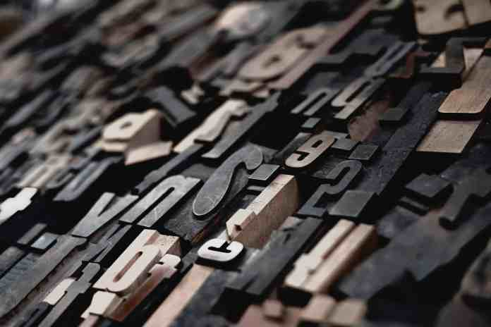 Closeup photo of cutout of typography letters