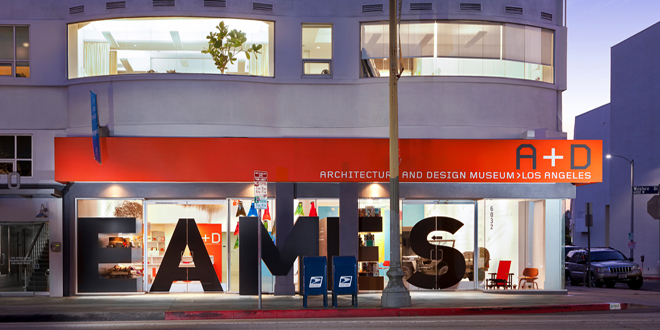 Façade of A+D Museum showing letters floating on storefront glass.