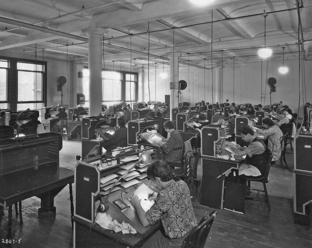 a 1930s interior of the Fleischer production room and the drawing-disc wedges in use