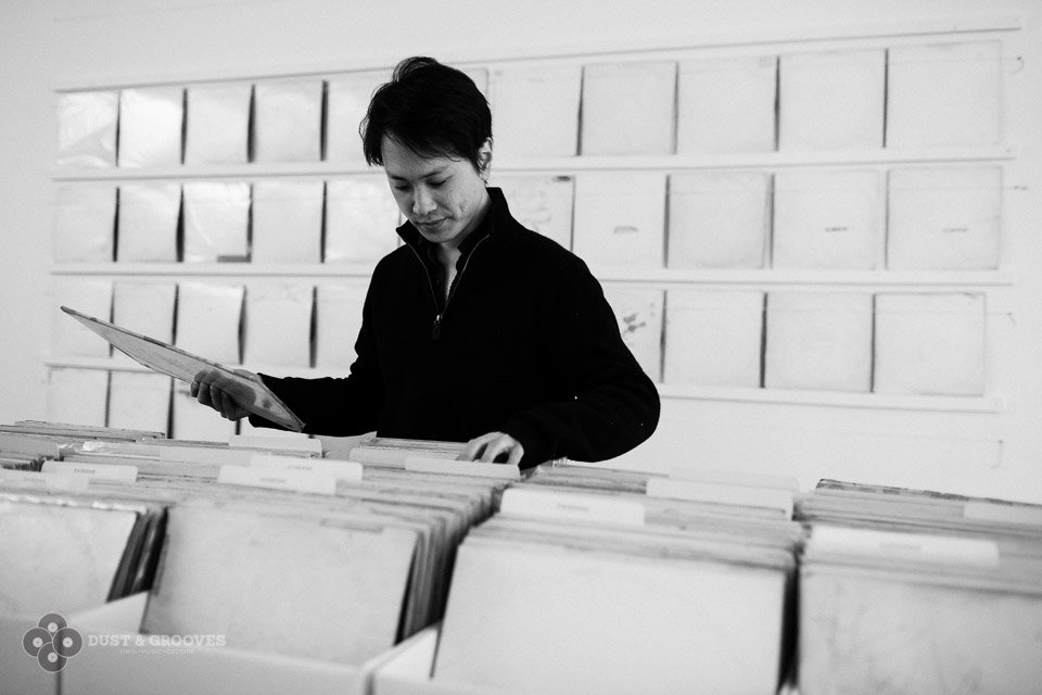 Artist Rutherford Chang in his exhibit We Buy White Albums at Recess. Image courtesy of Dust & Groove: http://www.dustandgrooves.com/rutherford-chang-we-buy-white-albums/