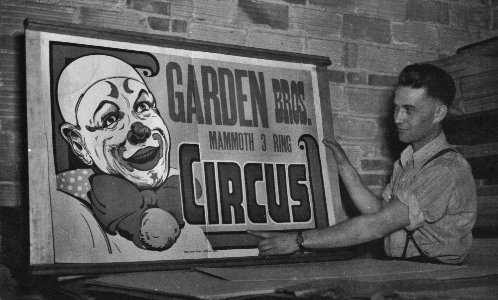 Bill King displays finished circus poster late 1940s.