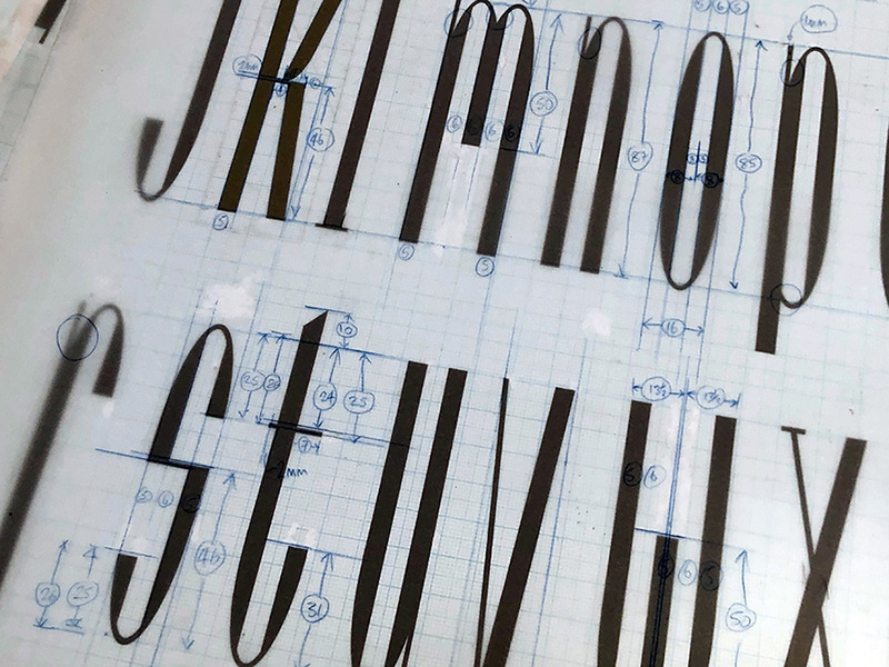 Original drawings and corrections overlay for Arcadia typeface, around 1986.