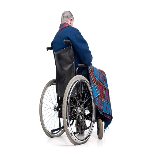 Lonely elderly man in a wheelchair
