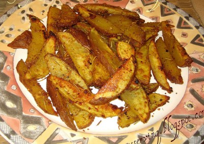 Spicy Baked Potato Wedges (Oven Roasted Rosemary Garlic Potatoes)