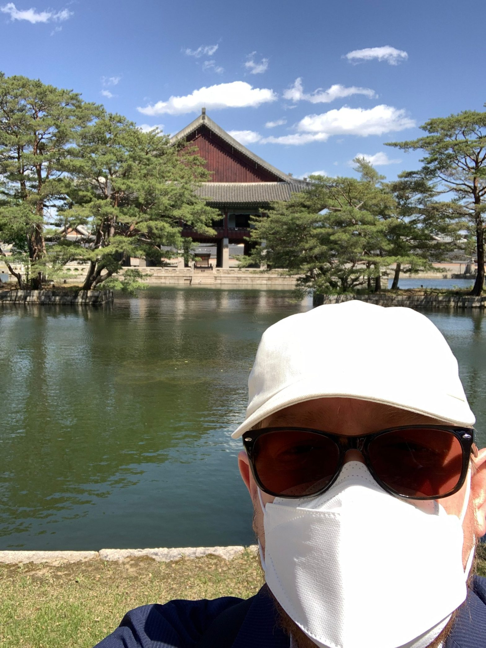 Paul in Seoul in front of a temple across the water