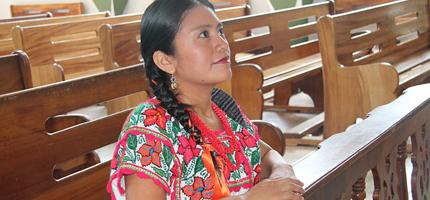 Mexican woman praying