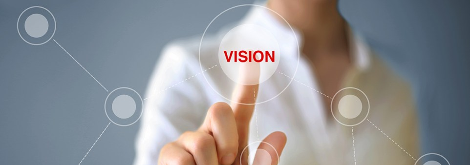 "Businesswoman pushing ""Vision"" on touch screen."