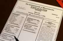 A photograph shows an example of a ballot form for a state election in Massachusettes.
