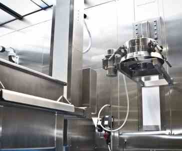 downflow containment booth vibratory sieve