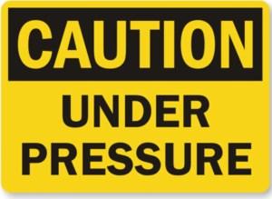 Caution under pressure
