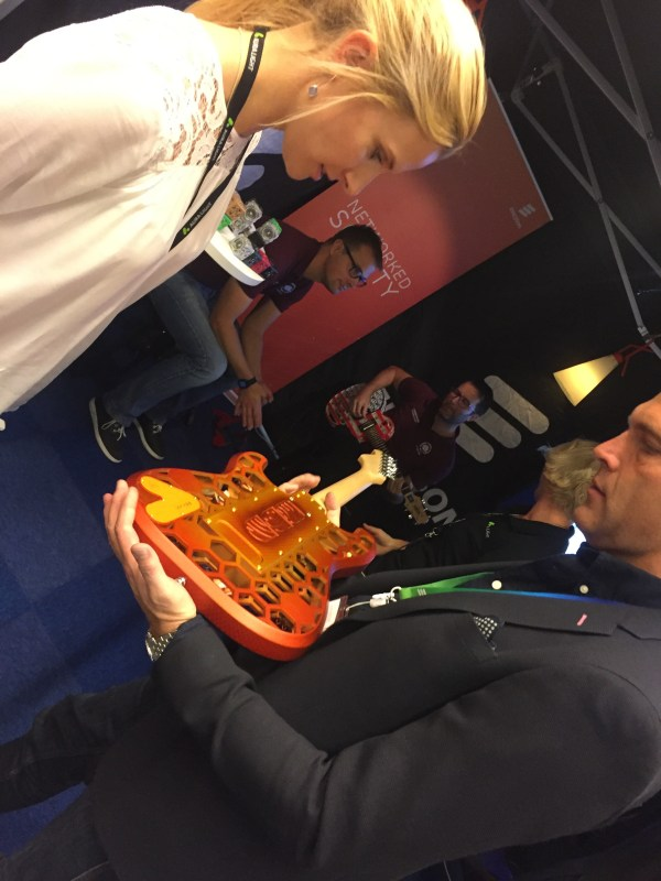Martin Wallin of Ericsson with one of the 3D printed guitars, Andreas Larsson playing the other one in the back.