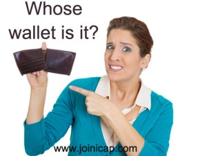 Shocked woman showing empty wallet