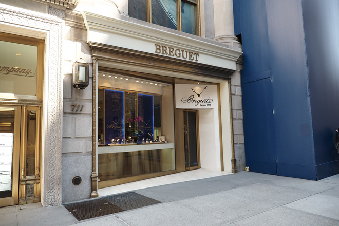 Breguet which is owned by the same parent group as Omega, the Swatch Group, is adjacent to Omega's flagship boutique. (711 5th Ave)