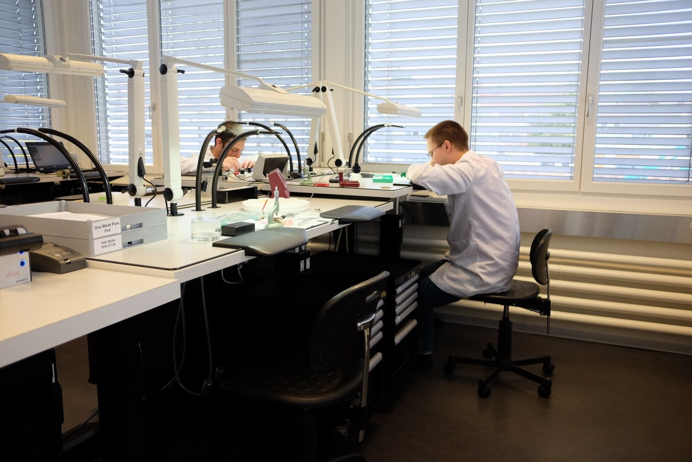 Watchmakers assembling and adjusting timepieces at Armin Strom