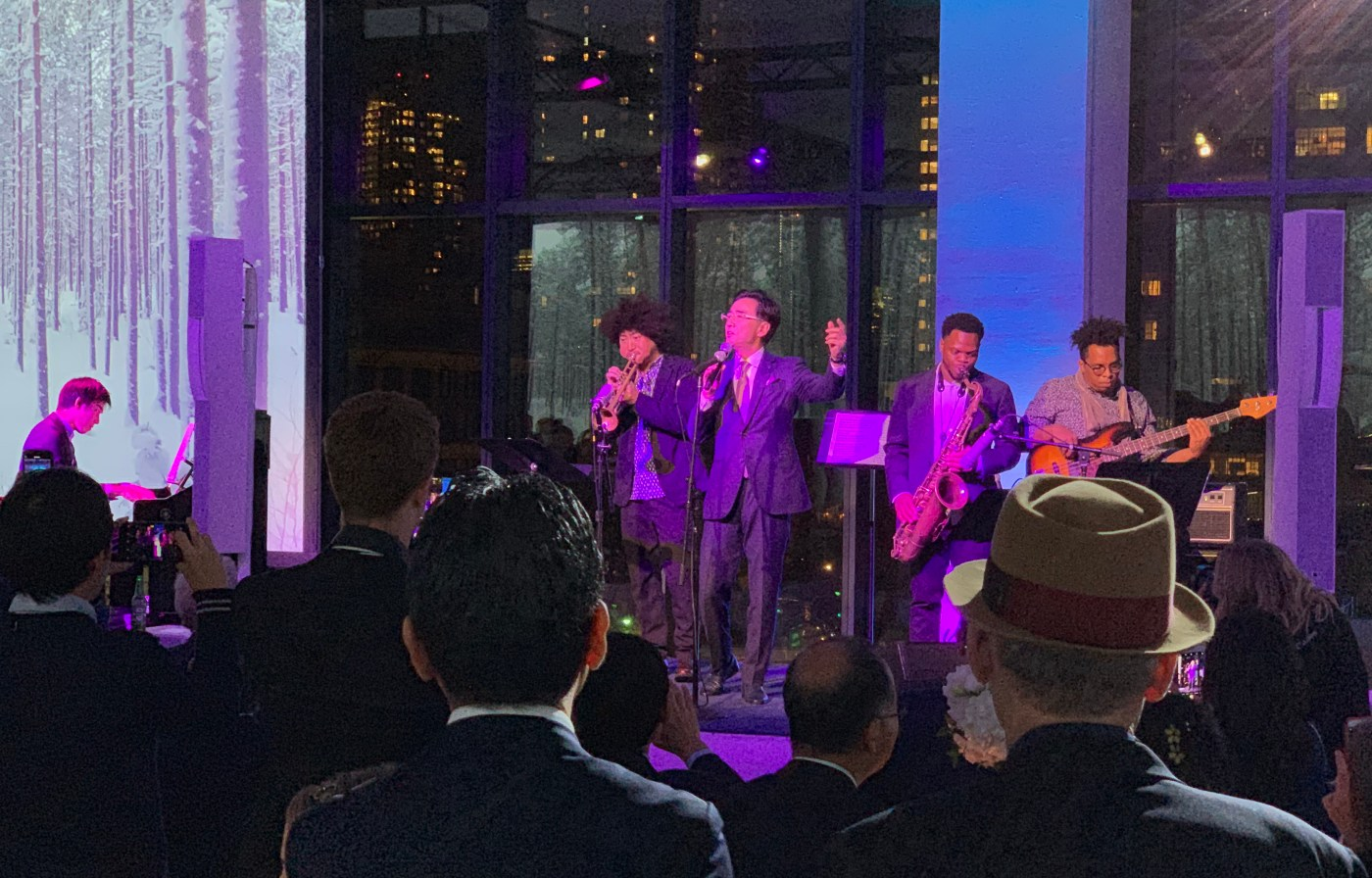 Seiko Chairman and CEO , Shinji Hattori, singing for the crowd at Spring Studios, during the inauguration of the Grand Seiko Corporation of America