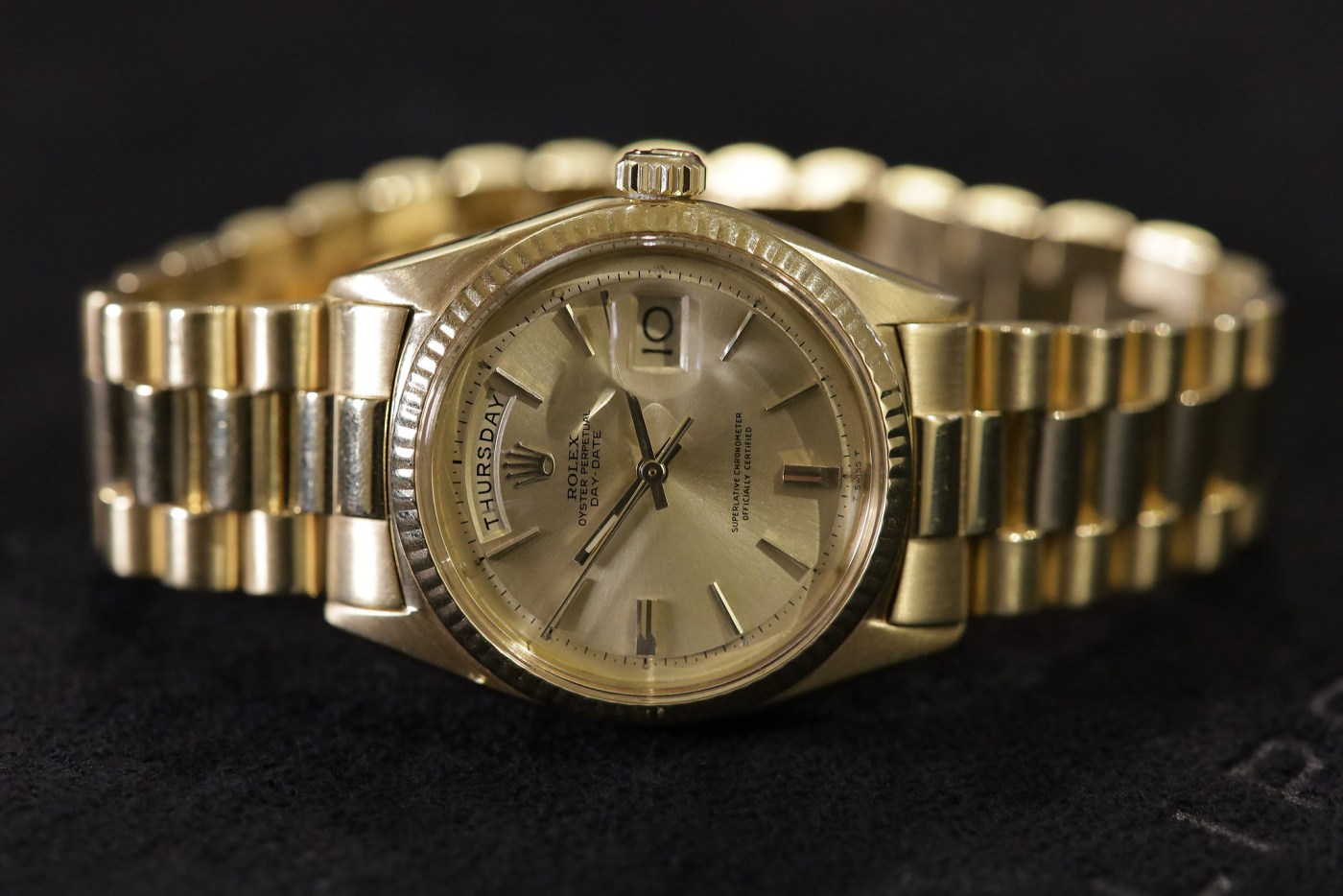 Jack Nicklaus 1967 Yellow Gold Rolex Day-Date Ref. 1803 laying on side