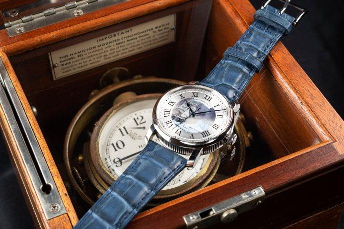 "RGM Model 25 ""Terra Nova"" on top of a marine chronometer"
