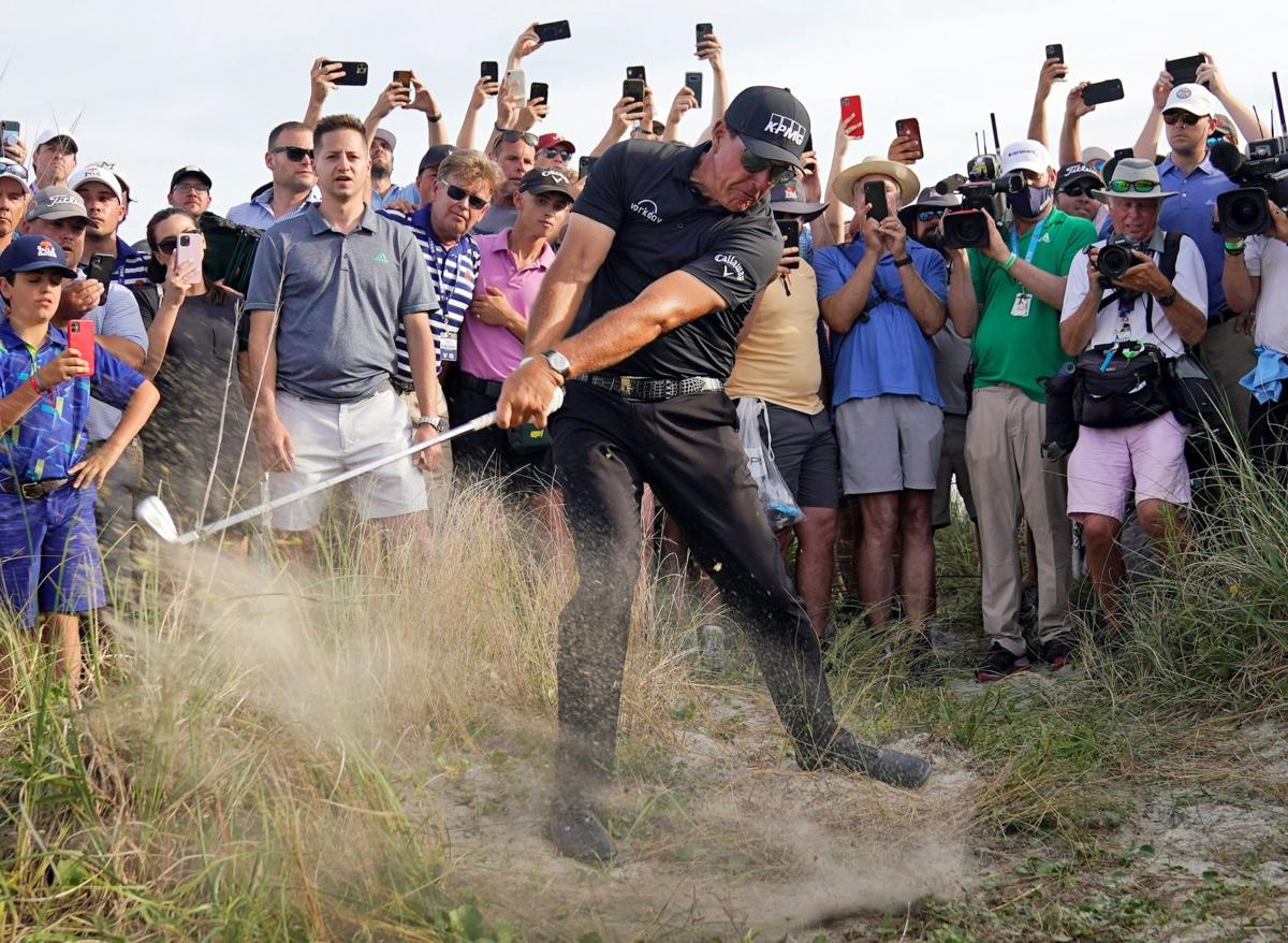 Phil Mickelson blasting a shot out of rough with Rolex Cellini on his wrist during 2021 PGA tournament