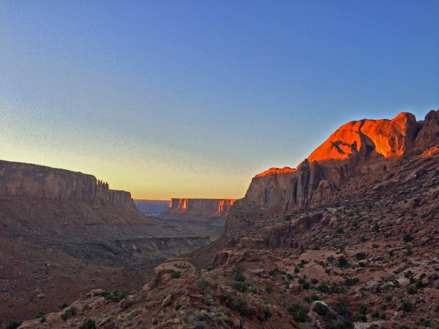 Climbing out of Upheaval Canyon, looking back NW at the sunset lights