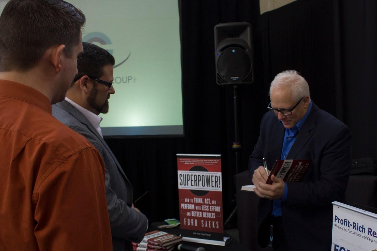 Ford Saeks signing books