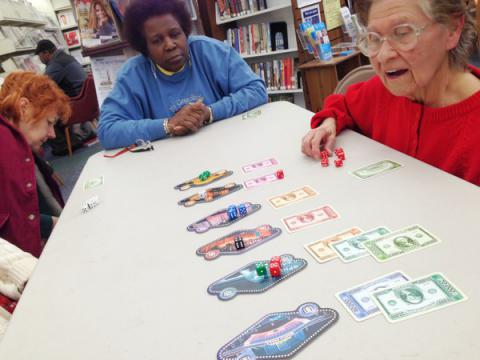 Seniors playing a board game