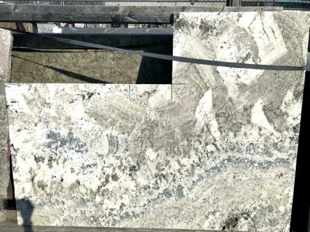 Beige, grey and white granite remnant from Progressive Countertop