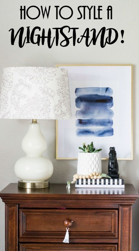 How To Style A Nightstand, How to decorate a nightstand, nightstand decor, watercolor print, wood bead garland, double gourd lamp, horse statue nightstand with tassels