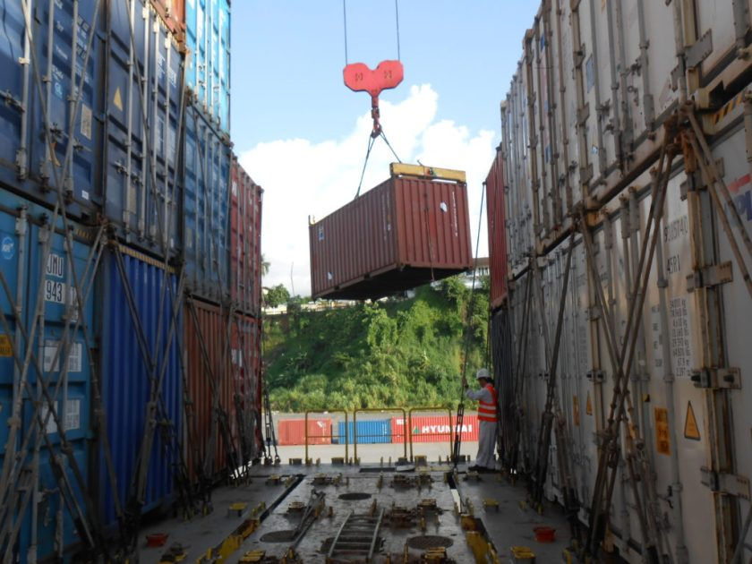 Crane lifting a container