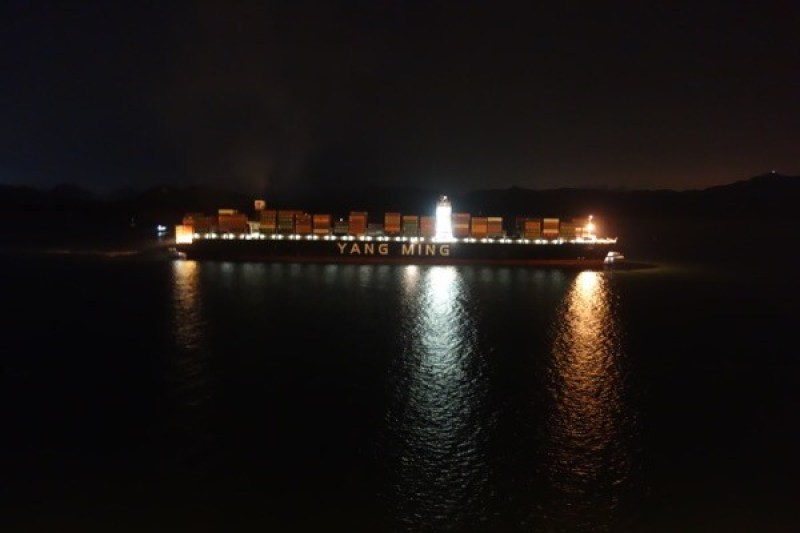 Nightview in Yantian of a 13000 TEU YANGMING LINE container vessel leaving port.