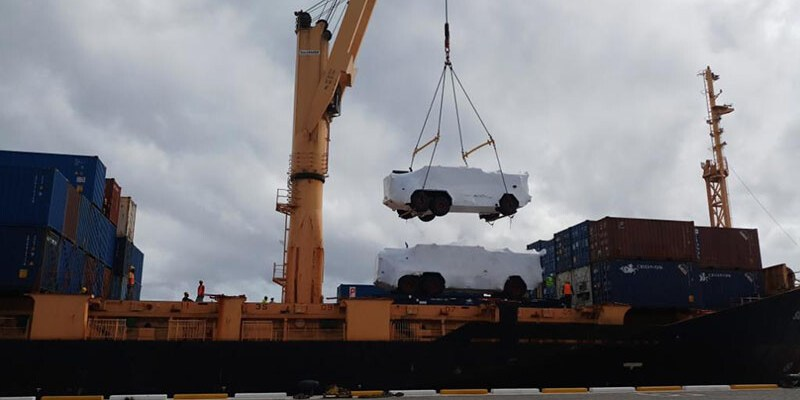 Crane lifting a large vehicle