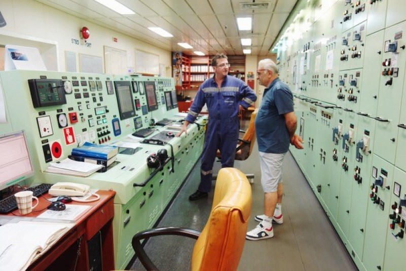 The ship's engine room and passenger Piccinino from Malta talking to the chief engineer.