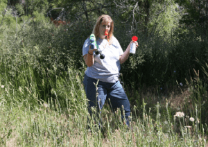 Ashley DeLaup, Wildlife Ecologist with Parks and Recreation of the City and County of Denver demonstrates a variety of coyote hazing tools.