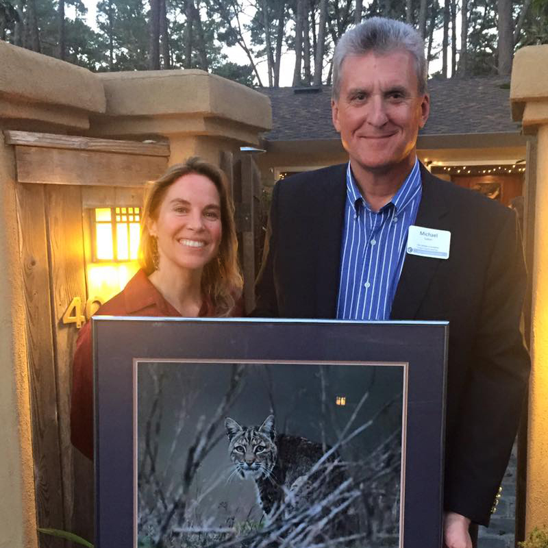 Camilla Fox presents Michael Sutton with Project Coyote's Wildlife Stewardship of the Year Award