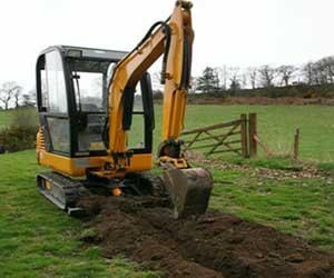 Excavator digging trench