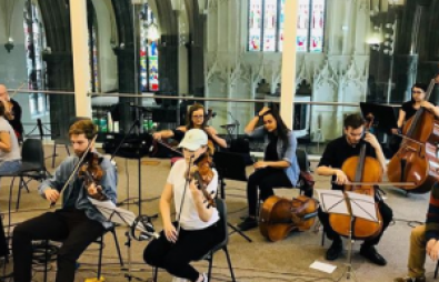 Photo of orchestra in a modern church