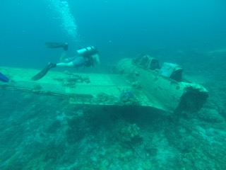 bentprop crew doing initial checkout dives on the Jake Japanese war plane, palau