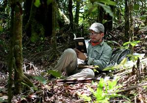 A moment of leisure for Derek reading a book in the jungles of palau