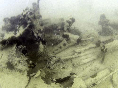 F6F 3 Hellcat found in Palau Underwater image of Lt. Punnell's hellcat tail wheel found in palau by bentprop.org